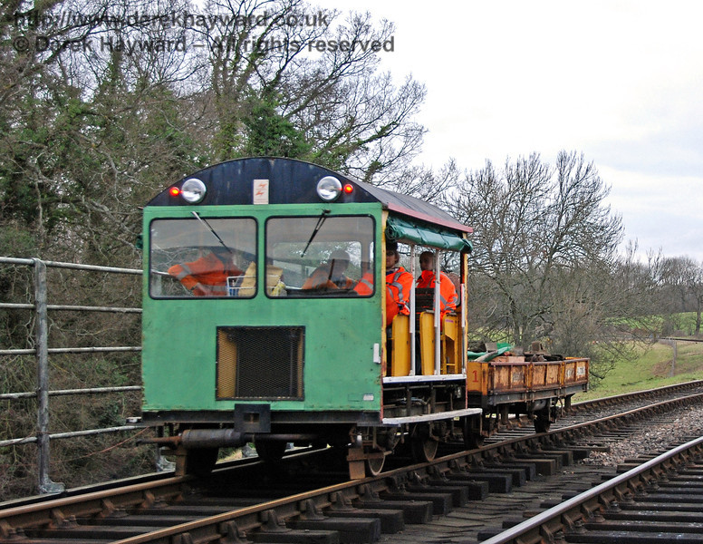 One of the Bluebell Railway's Type 18 Wickham trolleys crosses the River Ouse bridge. 24.01.2010