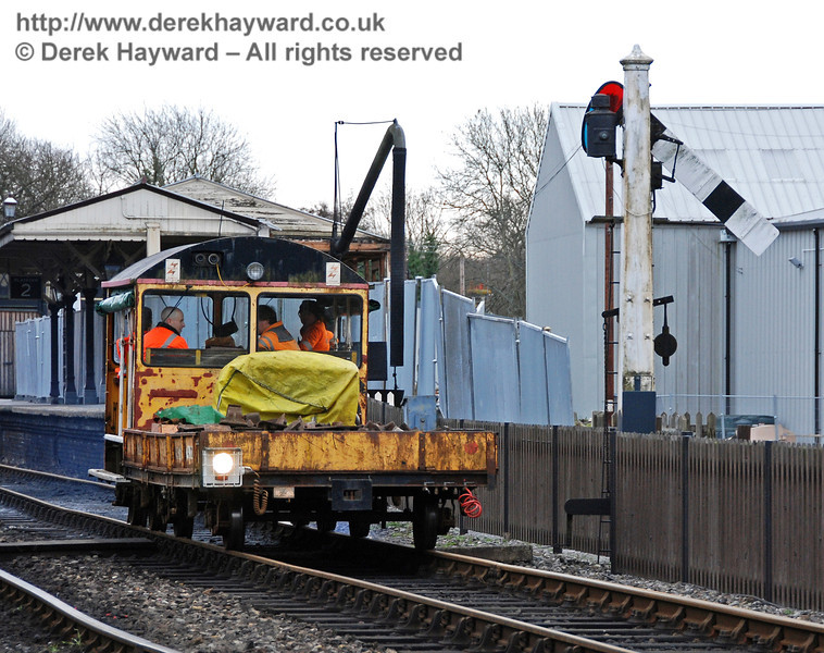 One of the Bluebell Railway's Type 18 Wickham trolleys reverses out of Platform 2 at Sheffield Park. 24.01.2010