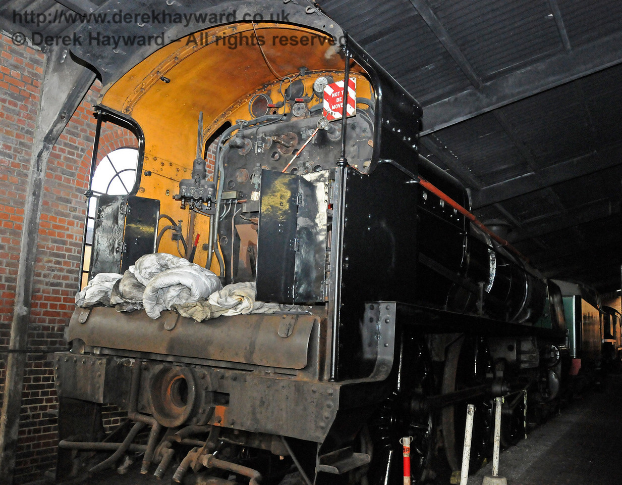 The temporary absence of the tender allowed this shot of the cab of 1618 in Sheffield Park Shed.  12.02.2011  5903