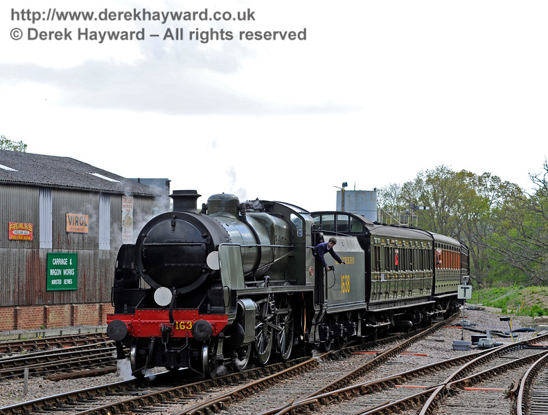 The crew prepare to surrender the single line token as 1638 approaches Horsted Keynes.  09.05.2015  11061