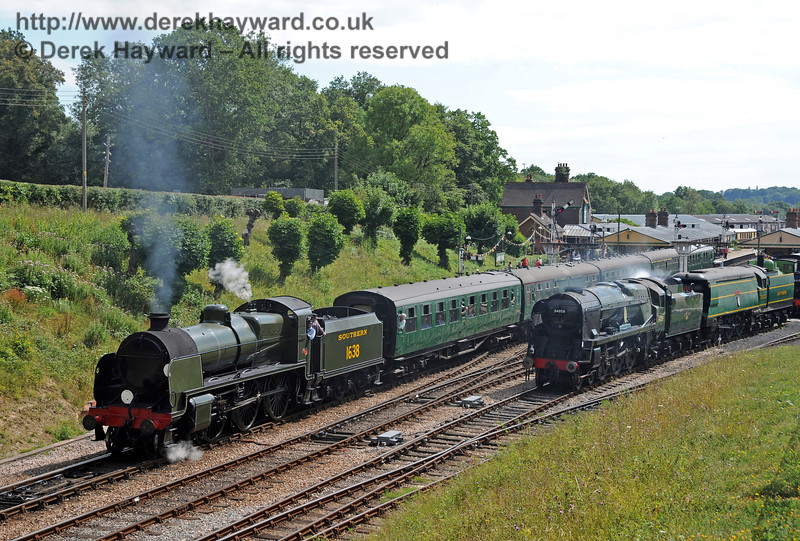 34059 and 21C123 stand in Horsted Keynes Up Yard as 1638 departs north with a service train.  24.07.2010  3321