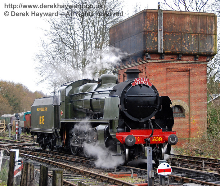 1638 passes the water tower as it emerges from Sheffield Park Shed. 05.12.2009