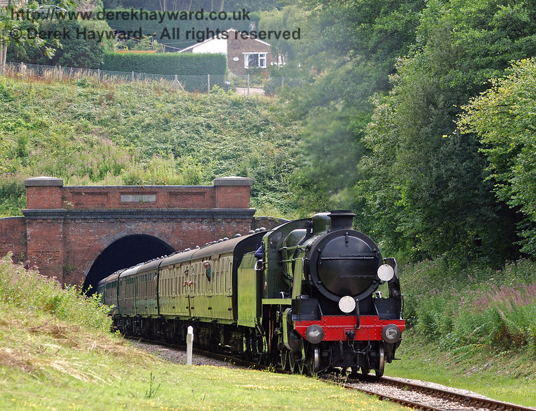 1638 emerges from West Hoathly Tunnel with a service train.  09.08.2010