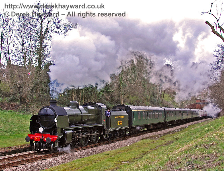1638 passes through the site of West Hoathly station with a service train. 29.03.2008