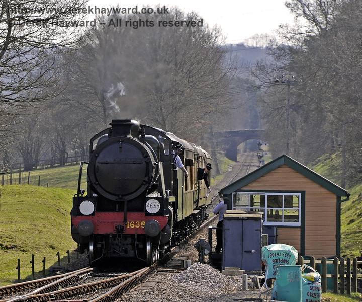 1638 surrenders the single line token at Kingscote signal box.  25.03.2012  3954