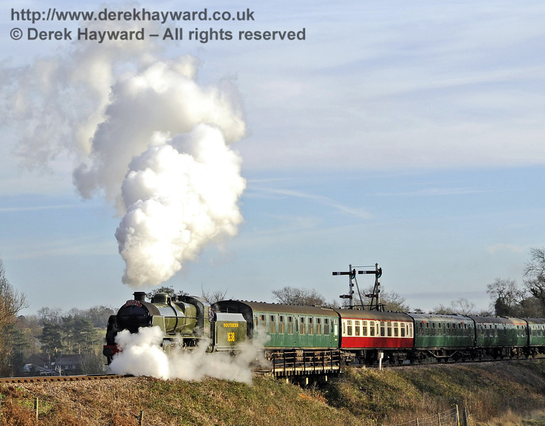 1638 creates steam effects as it passes over Poleay Bridge with a Santa service.  10.12.2011