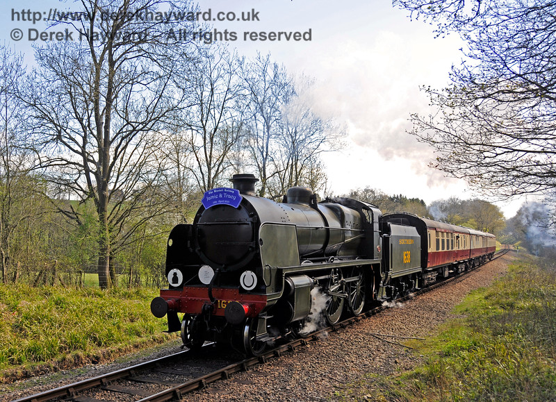 1638 climbs north towards West Hoathly tunnel with a Wedding Special.  18.04.2015  12261