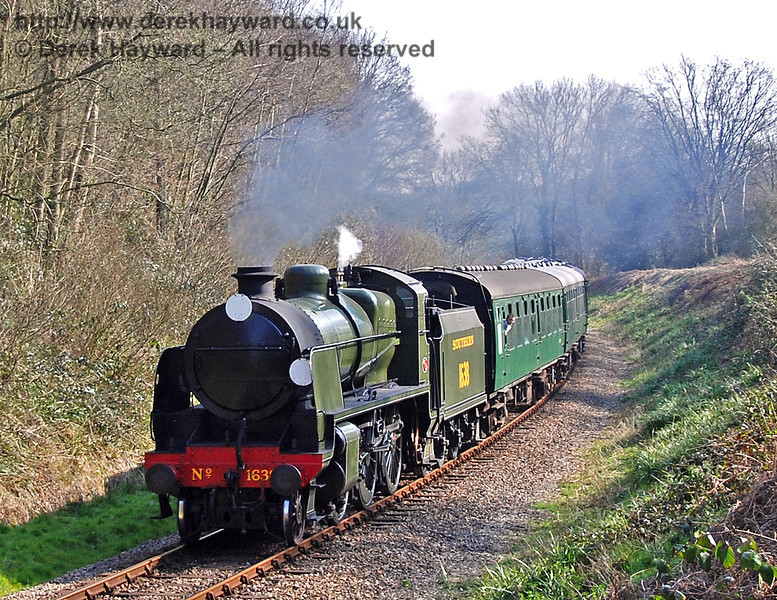 1638 steams through Lindfield Wood with a service train. 02.04.2007