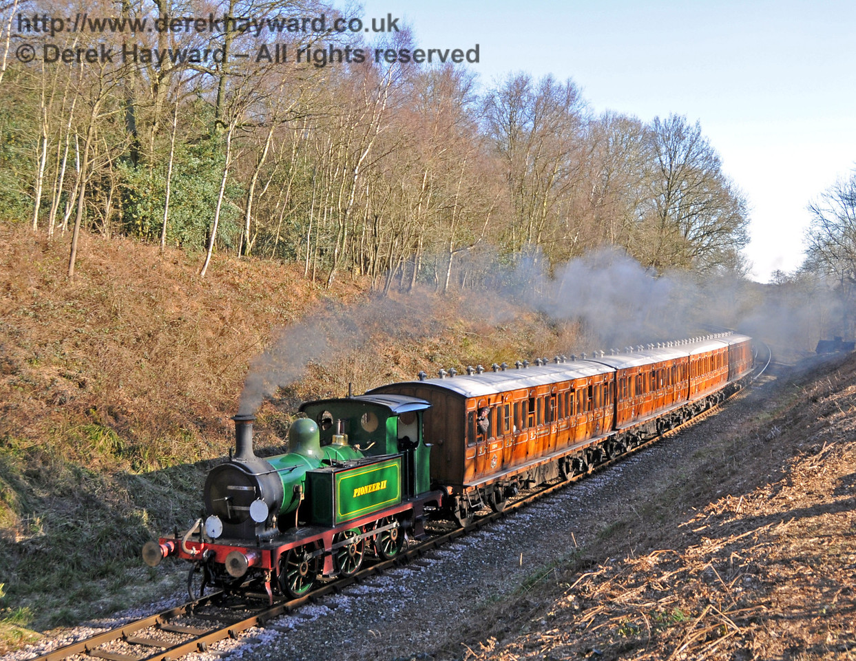 Pioneer II passes through Lindfield Wood with 672 Fenchurch on the rear of the train. 07.03.2010  1269