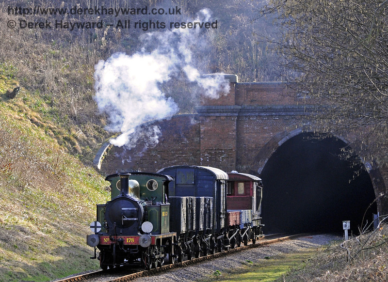 178 emerges from West Hoathly Tunnel with a goods train.  10.03.2012  7700
