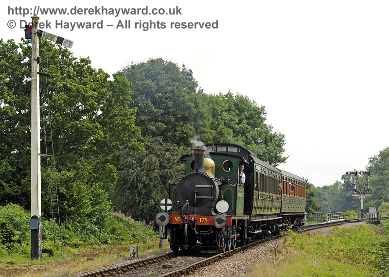 178 passes the Sheffield Park Advance Starter with a relief train.  12.07.2014  9879