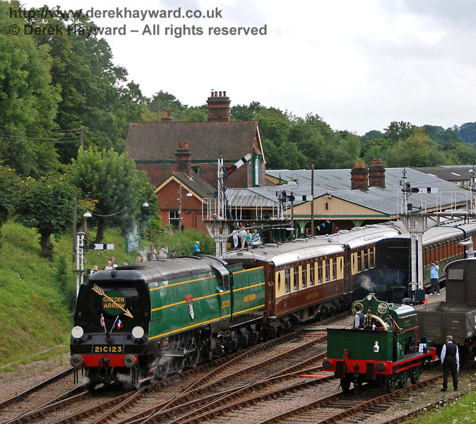 Little and large. The crew of Sir Berkeley watch as 21C123 Blackmoor Vale passes with the Pullman. Horsted Keynes 12.08.2007