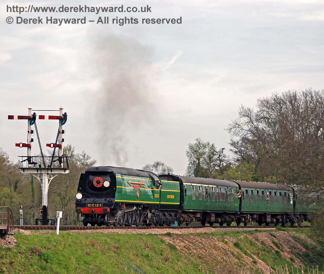 21C123 OVS Bulleid passes the Sheffield Park Inner Home bracket signal with a service train. 26.04.2008