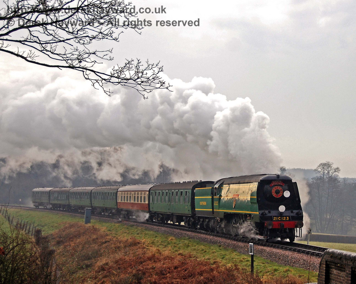 On a drab and misty December day just before Christmas 21C123 OVS Bulleid approaches Horsted Keynes with a Santa Special. 22.12.2007