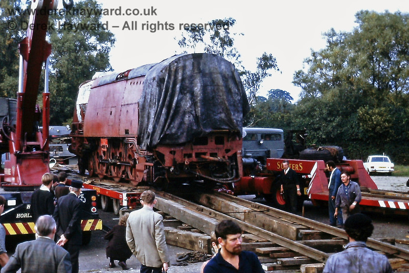 Unloading Blackmore Vale at Sheffield Park on Wednesday 29 Septmber 1971.  The rails connecting the trailer are in position.....   Eric Kemp retains all right to this image.