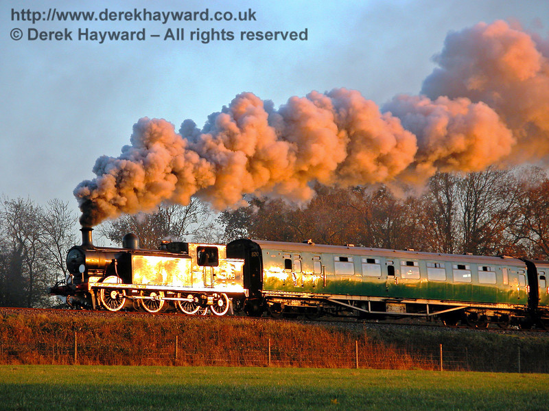 The low November sun produces a golden glow as 32473 steams towards New Road Bridge.  17.11.2005