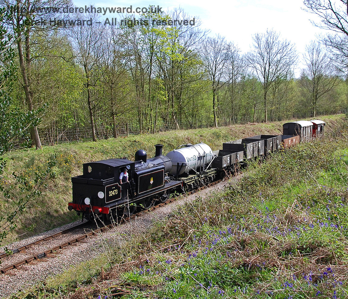 32473 steams towards Deans Crossing with a goods train.  26.04.2008
