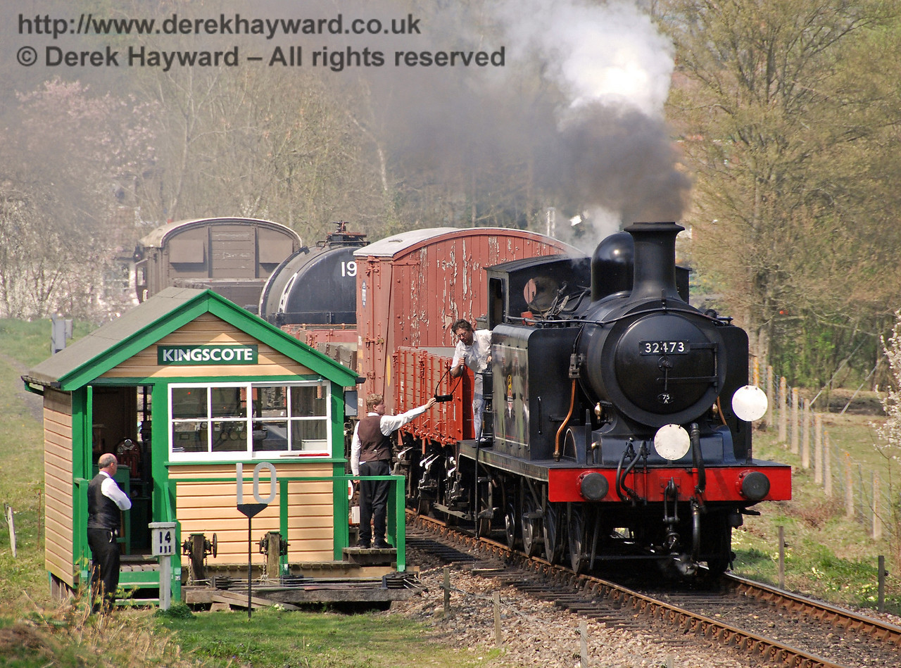 The crew of 32473 collect the single line token as they steam south past Kingscote signal box.  14.04.2007