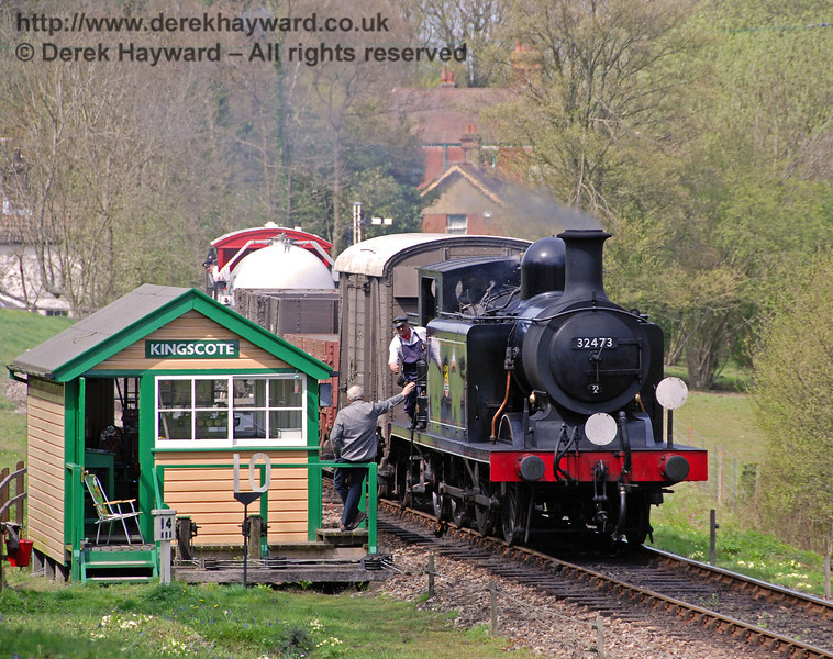 The crew of 32473 receive the single line token as they pass Kingscote signal box with a goods train.  26.04.2008