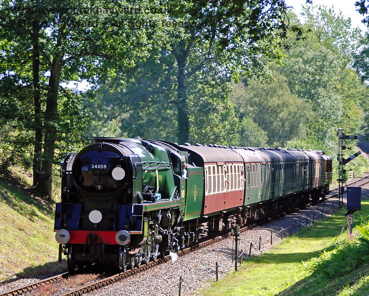 34059 Sir Archibald Sinclair steams through Mill Place cutting with a service train. 23.08.2009  0027