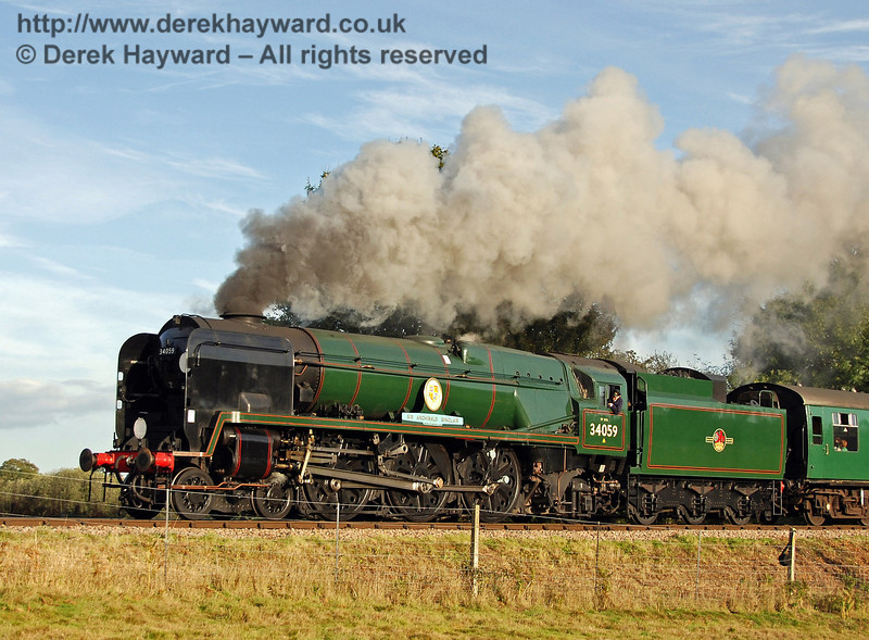 34059 Sir Archibald Sinclair in full steam north of Sheffield Park. 10.10.2009  0178