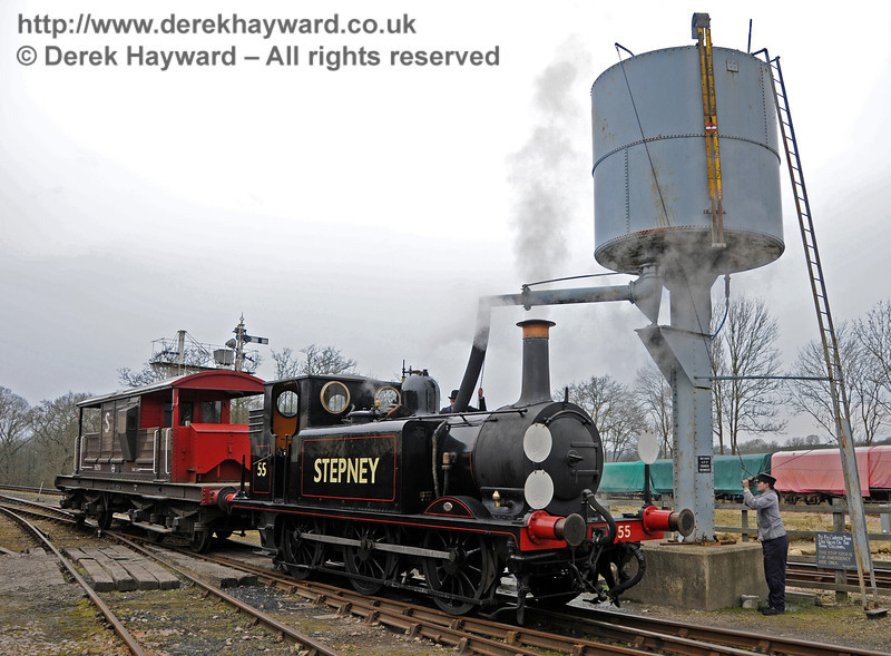 In an interval between Brake Van rides, 55 Stepney takes water in the Down yard at Horsted Keynes.  12.03.2011  6255