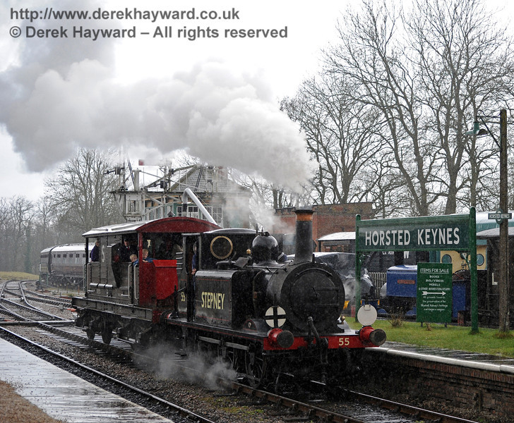 It is not grain or noise on the image - the rain is lashing down as 55 Stepney returns to Horsted Keynes with the brake van.  Drops of rain can even be seen bouncing up off the platform.  13.03.2011   0386