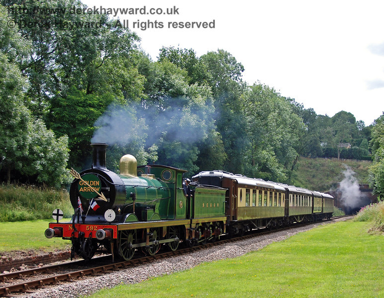 592 passes through the site of West Hoathly station with the Golden Arrow. 26.07.2009