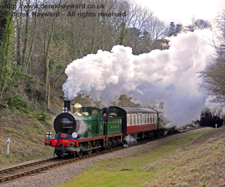 592 emerges from West Hoathly Tunnel with the Wealden Rambler.  13.02.2010  0535