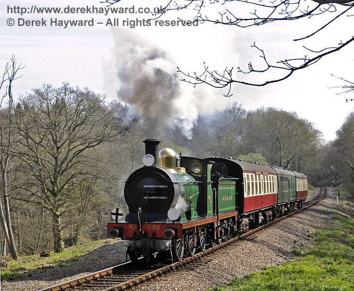 592 steams towards West Hoathly Tunnel with the Wealden Rambler.  06.04.2012  4345