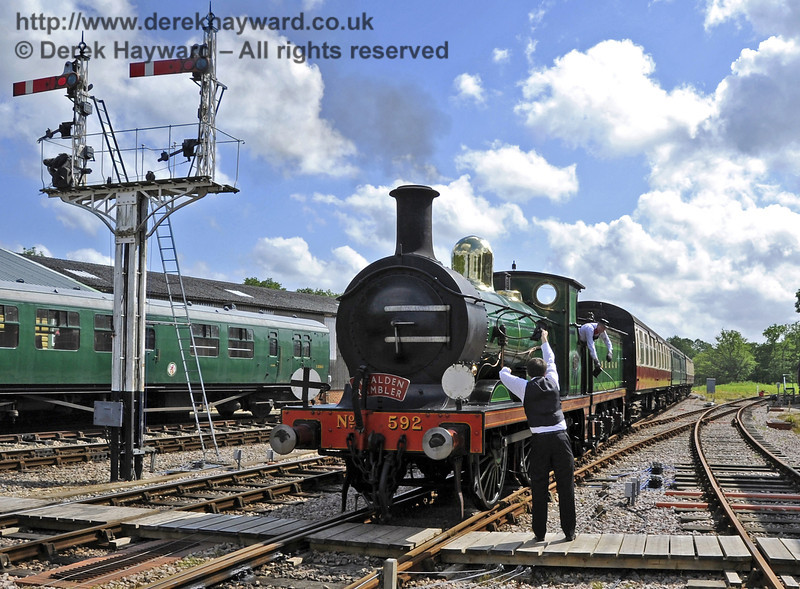 The crew of 592 prepare to exchange tokens with the signalman at Horsted Keynes.  16.06.2012  5131