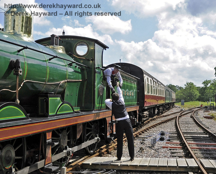 The crew of 592 exchange tokens with the signalman at Horsted Keynes.  16.06.2012  5135