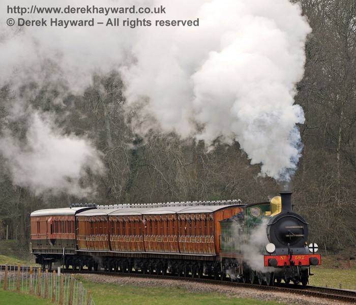 592 rounds the curve north of Three Arch Bridge with the Victorian coaches.  12.03.2011  0256