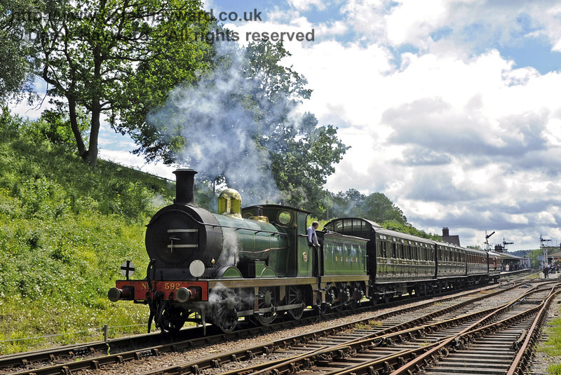 592 leaving Horsted Keynes with a northbound service.  24.06.2012  5459