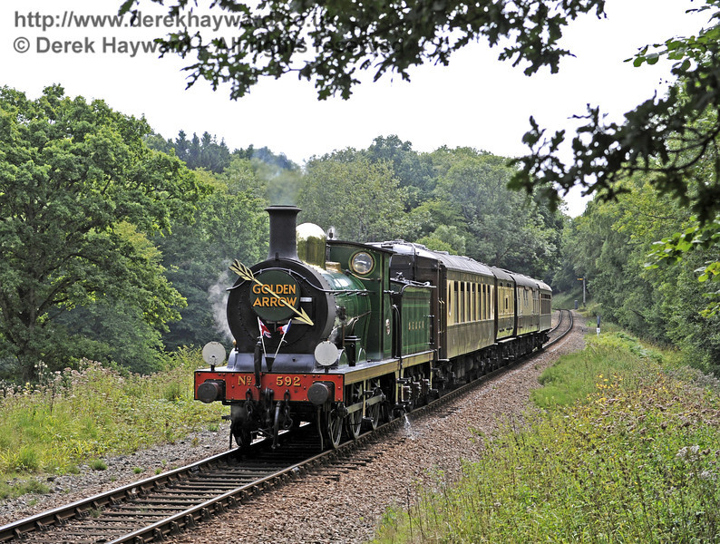 592 steams towards West Hoathly Tunnel with the Golden Arrow.  01.09.2013  8012