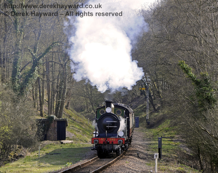 592 passes Black Hut on the climb to the tunnel.  06.04.2012  7773