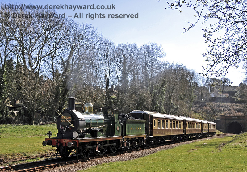 592 passes through the site of West Hoathly station with the Golden Arrow.  16.03.2014  10036