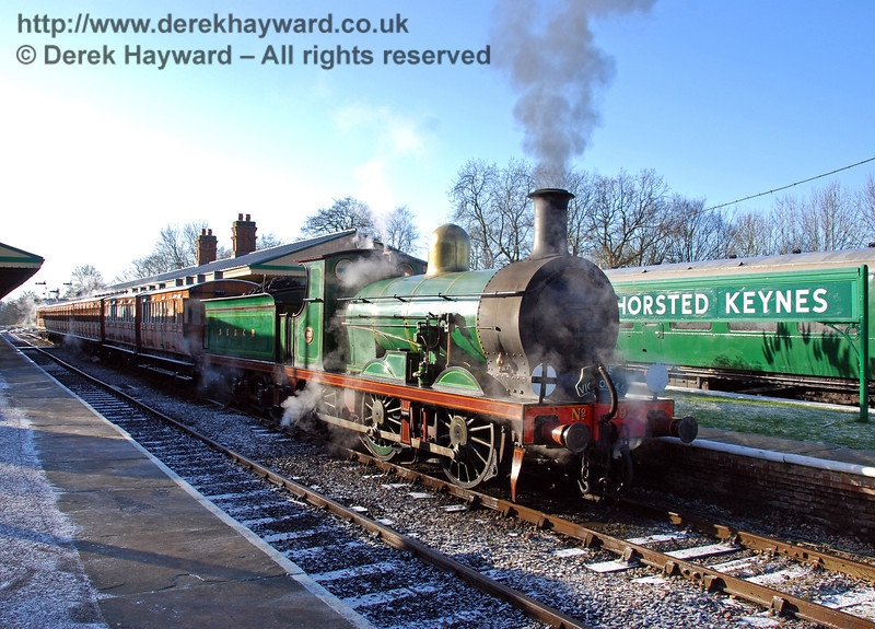 592 stands at Horsted Keynes with a Victorian themed train.  02.01.2010  0024