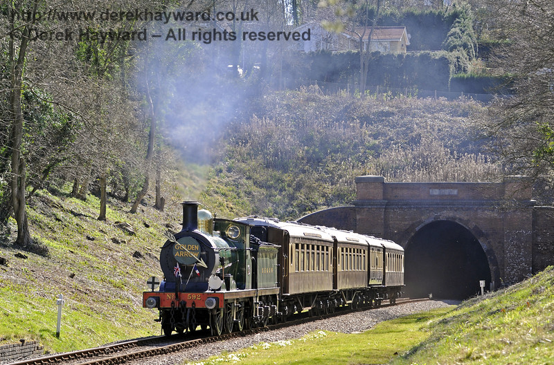 592 emerges from West Hoathly tunnel with the Pullman.  16.03.2014  8717