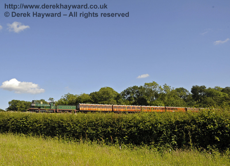 592 steams towards Horsted Keynes with the Victorian coaches.  19.06.2012  5189