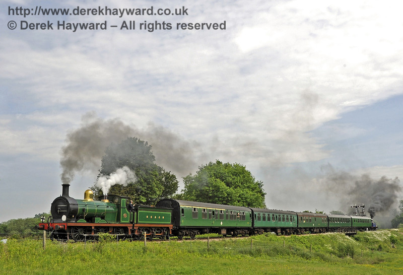 592, assisted at the rear by 323 Bluebell, leaving Sheffield Park with a service train.  30.05.2012  4960