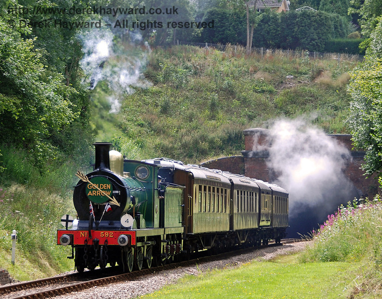 592 emerges from West Hoathly tunnel with the Golden Arrow. 26.07.2009  0005