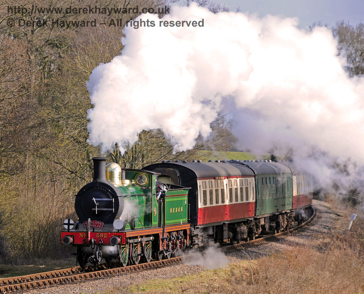 592 rounds the curve over Sloop Bridge with the Wealden Rambler.  06.03.2010  1040