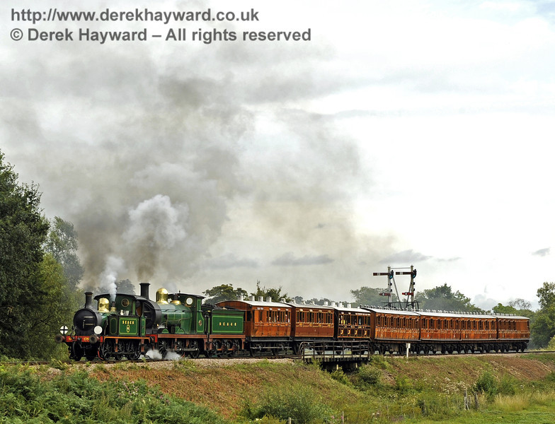 178 and 592 steam north over Poleay Bridge with the Victorian coaches.  13.08.2011  2493
