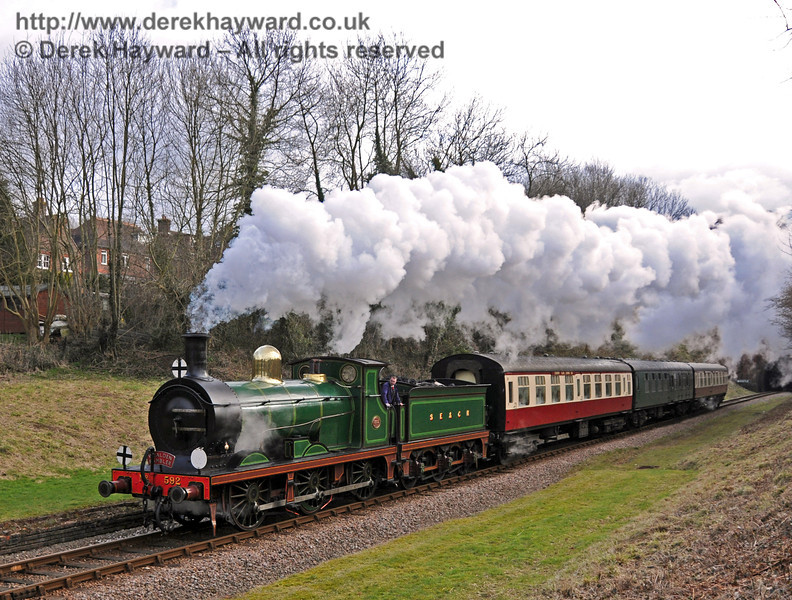 592 steams through the site of West Hoathly station with the Wealden Rambler.  13.02.2010  0538
