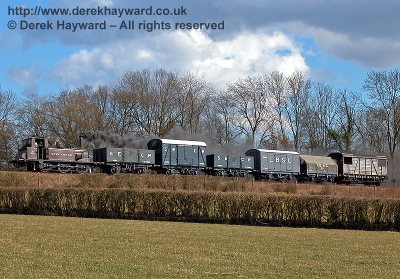 672 Fenchurch steams north towards Horsted Keynes with a goods train. 09.04.2006