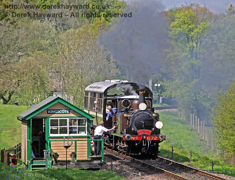 The crew of 672 Fenchurch collect the single line token as they leave Kingscote.  29.04.2009  0024