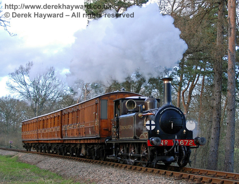 672 Fenchurch hauls the Victorian coaches south from Birch Farm foot crossing.  21.01.2007