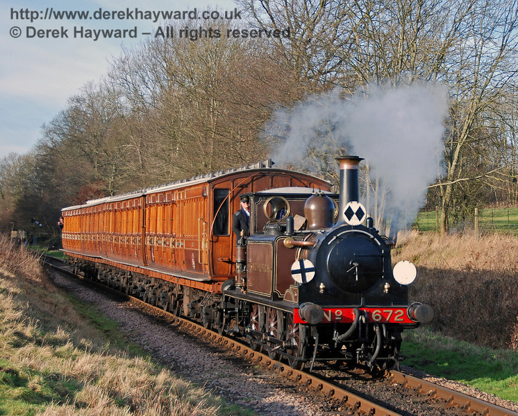 672 Fenchurch steams south from Ketches Halt with the Victorian coaches. 12.01.2008  0014