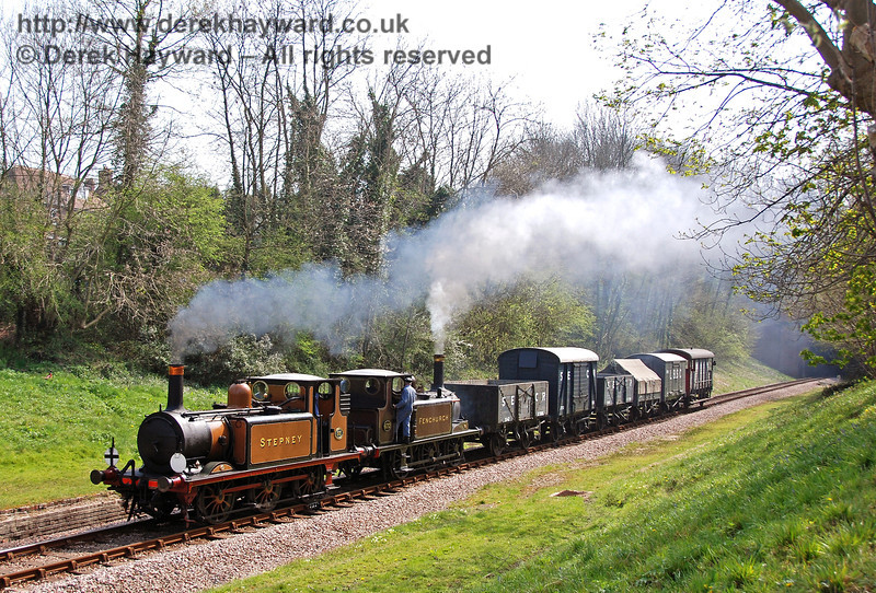 55 Stepney and 672 Fenchurch pass through the site of West Hoathly station with a goods train. 14.04.2007